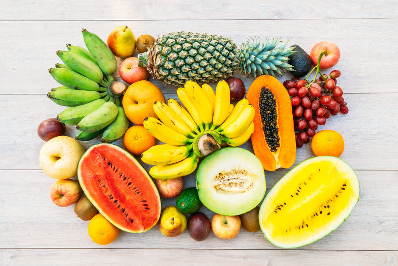 A variety of fruits are shown, which are ideal to eat when you're sick for calories as well as healthy nutrients.