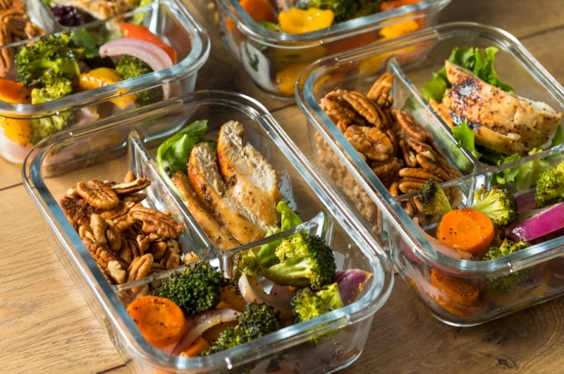 A set of 4 different meals, prepared early to eat in the future.