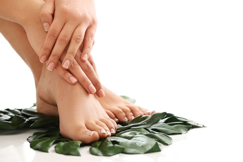 A young woman's feet are recently manicured and are now clean.