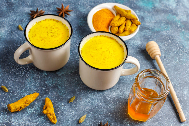 Two cups of turmeric and milk drinks.